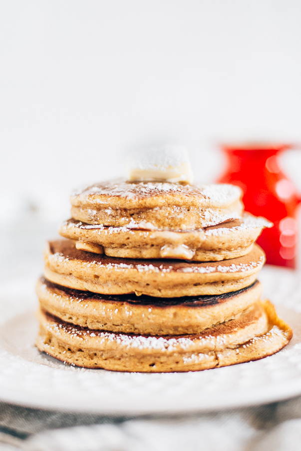 white plate and white background with a stack of pancakes