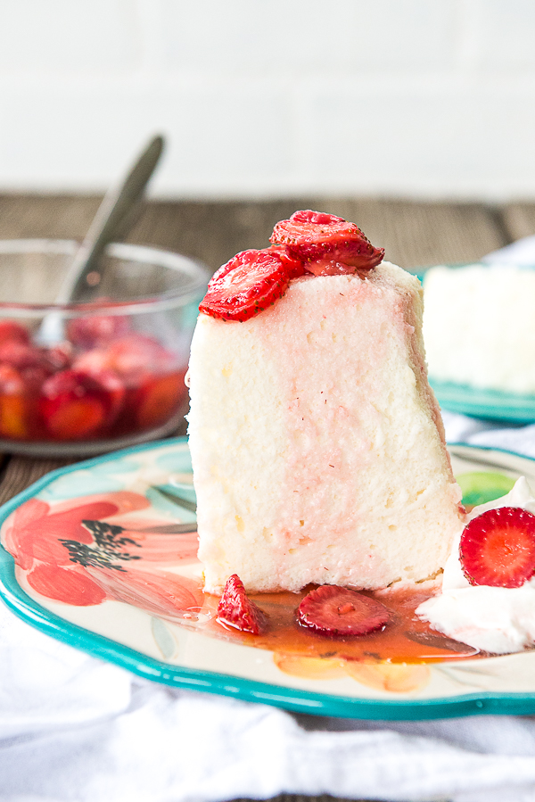 Image is a slice of angel food cake with strawberries