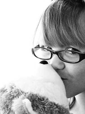 Girl Kissing Hallmark Jingle Stuffed Dog