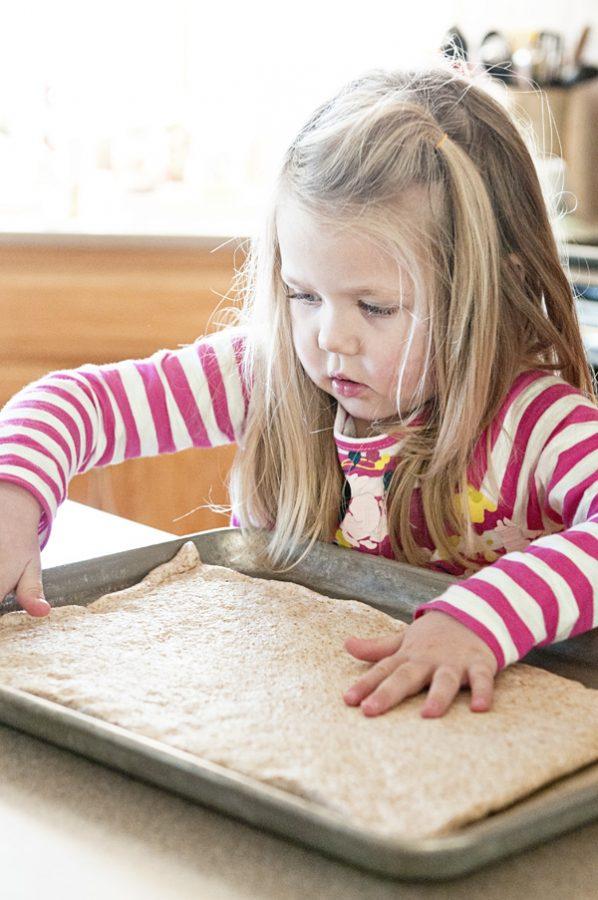 Little Girl Rolling Pizza Dough