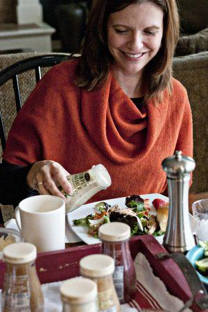 Woman Pouring Marzetti Salad Dressing