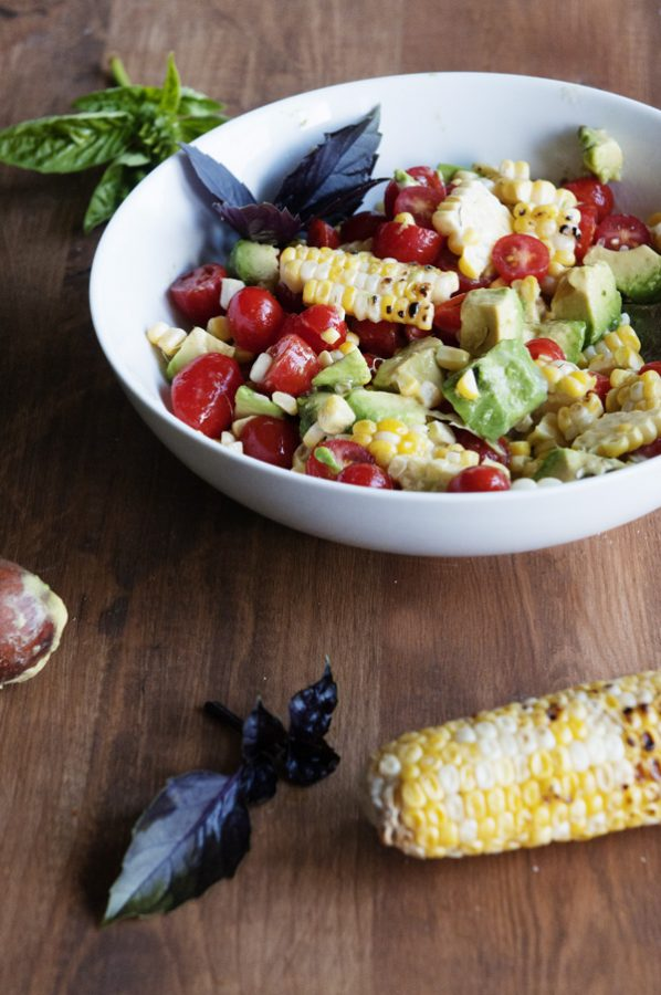 Bowl of Summer Harvest Salad with Avocado Tomato and Corn on the Cob