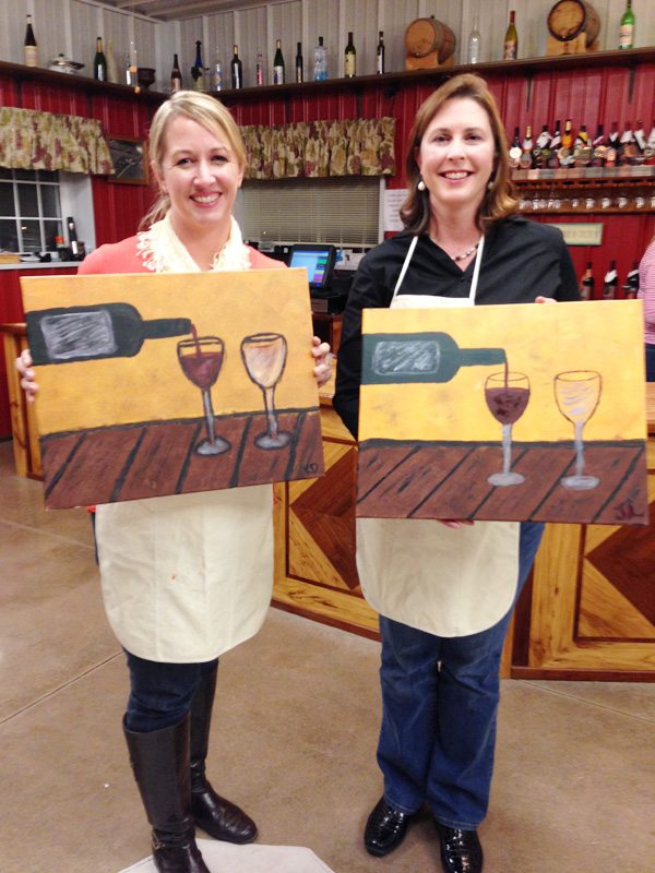 Jenny Long and I with our paintings from Friendship  Art night at the winery