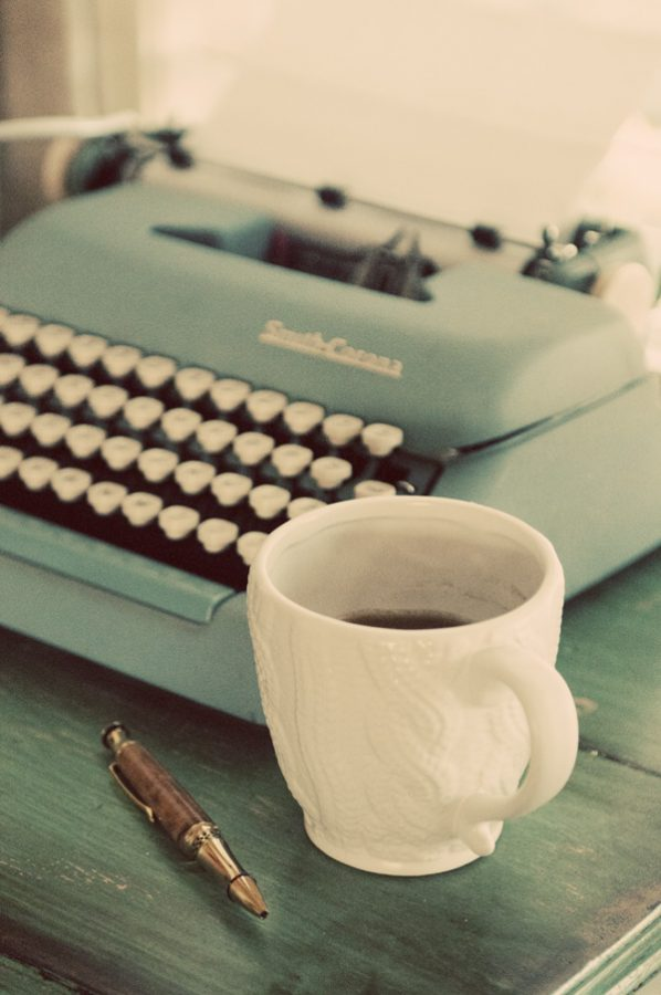 Vintage Typewriter and White Coffee Cup