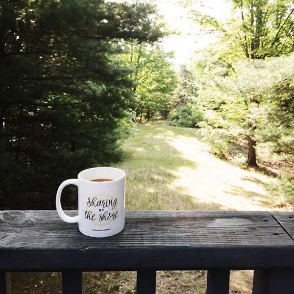 Sharing by the shore Coffee Mug