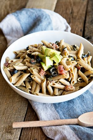 Whole wheat pasta is tossed in a creamy California Avocado sauce. A simple recipe from dineanddish.net