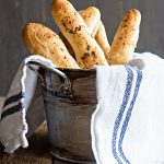 Beginner Breadsticks Recipe with instructions in the bread machine as well as by hand. From dineanddish.net