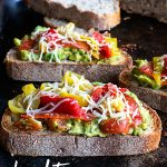 Amp up lunchtime with this loaded Lunchtime California Avocado Toast recipe on dineanddish.net