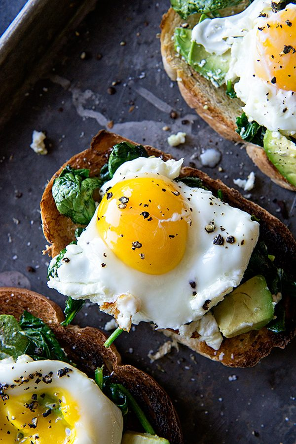 Eggs Florentine Avocado Toast Recipe on dineanddish.net