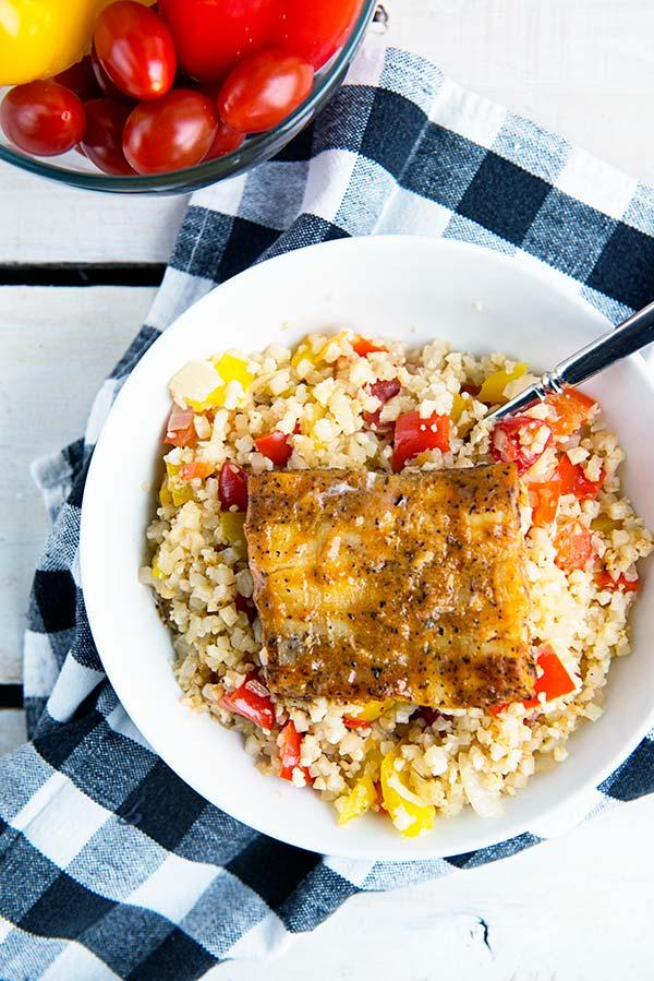 Cajun Cauliflower Rice Bowl with Cajun Grilled Alaskan Pollock recipe from dineanddish.net