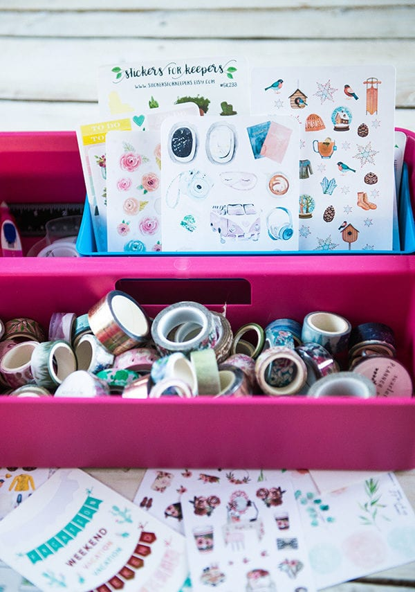 Pink bucket full of washi tape and cullet journal stickers