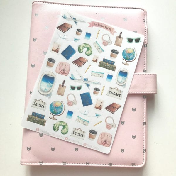 Travel sticker sheet on a pink notebook
